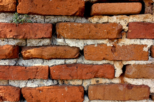 A masonry brick wall